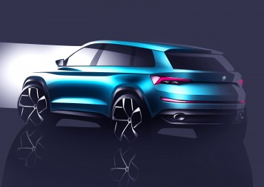 The rear of ŠKODA's VisionS has been sculpturally designed. A strong diffuser insert borders the large exhaust pipes, giving the large SUV a visually powerful stance on the road.