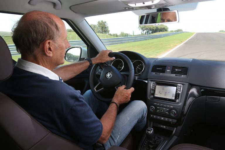 Driving on the racing line, both hands on the steering wheel and with a perfect seating position: Hans-Joachim Stuck, racing pro from Upper Bavaria, driving a ŠKODA on a race-track