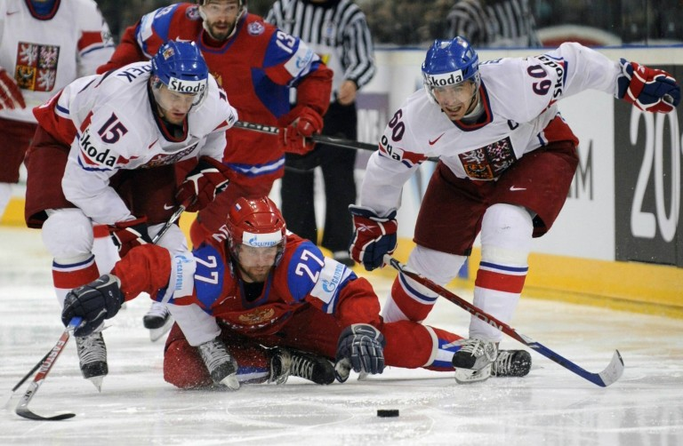 The Czech Republic plays Russia in the final of the World Championship 2010 in Cologne: Czech players Tomáš Rolinek (right) and Jan Marek (left) are battling with the Russian Pavel Datsyuk for the puck. The Czech Republic won 2–1 to become world champions.