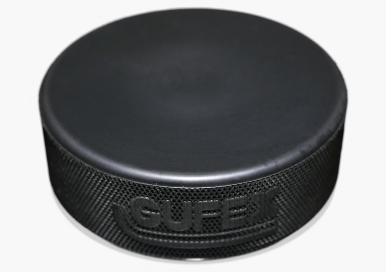 The puck is made of hard rubber and can slide across the  ice at up to 170 km/h. The size and weight are defined to international standards issued by the International Ice Hockey Federation (IIHF).