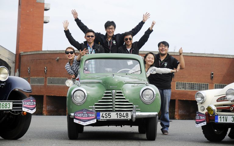 Chinese journalists on the road in vintage ŠKODAs