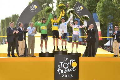 Tour de France winner Christopher Froome raises the ŠKODA crystal glass trophy up into the sky