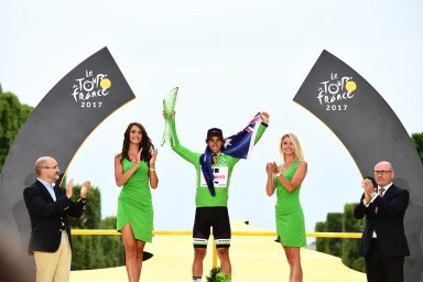 Tour de France winner Christopher Froome raises ŠKODA crystal trophy into Parisian sky
