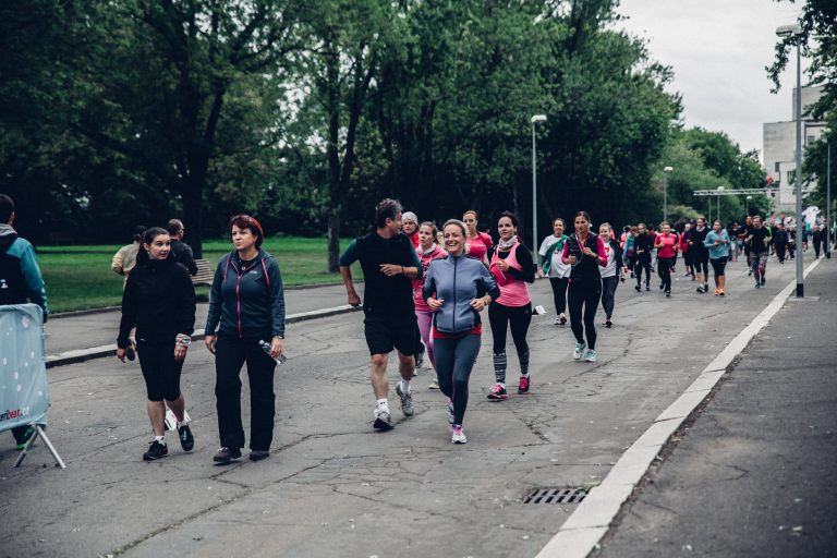 Marathon runners helping children
