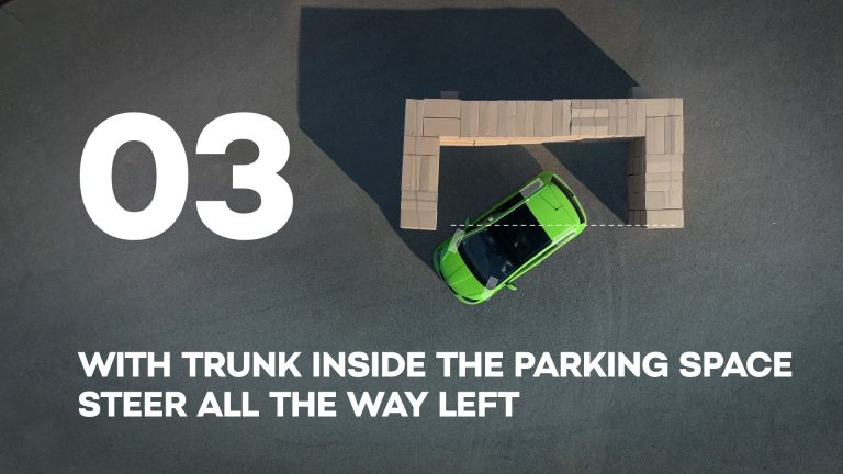 With trunk inside the parking space steer all the way left