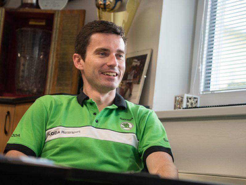 Kopecky-behind-desk-interview