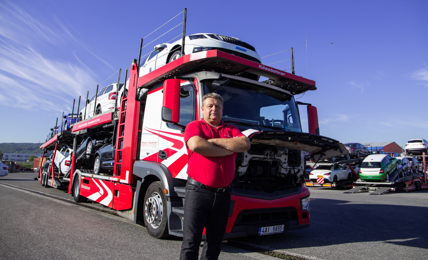 Jaroslav-Tetek-posing-in-front-of-truck