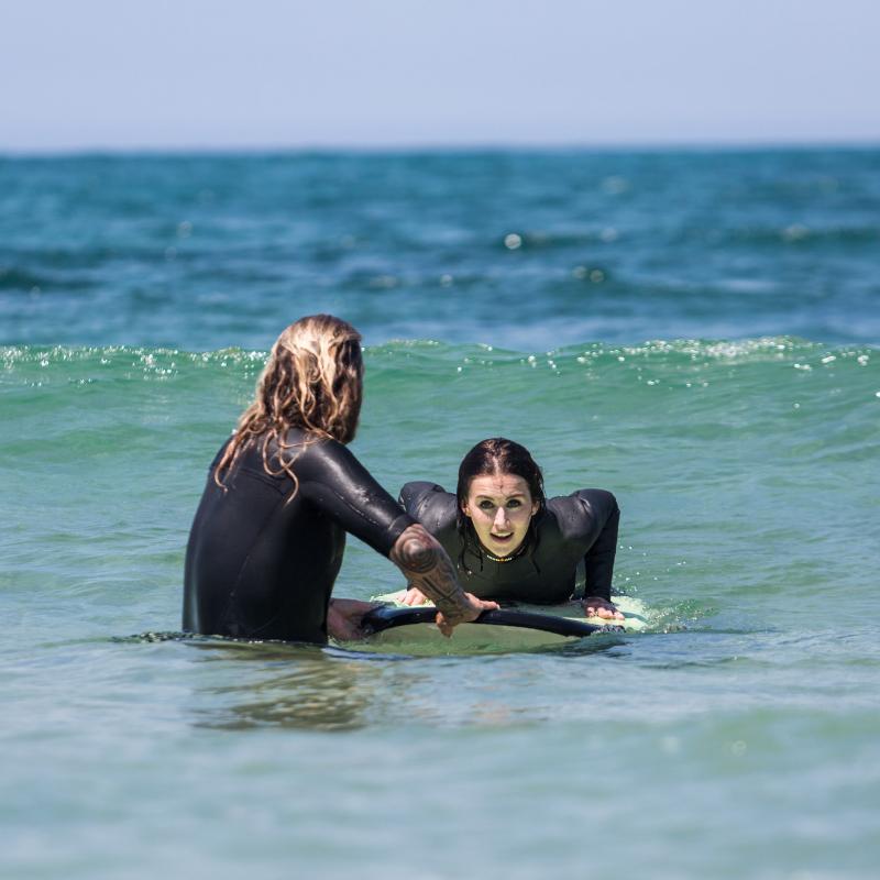 Nina-lies-on-the-surf