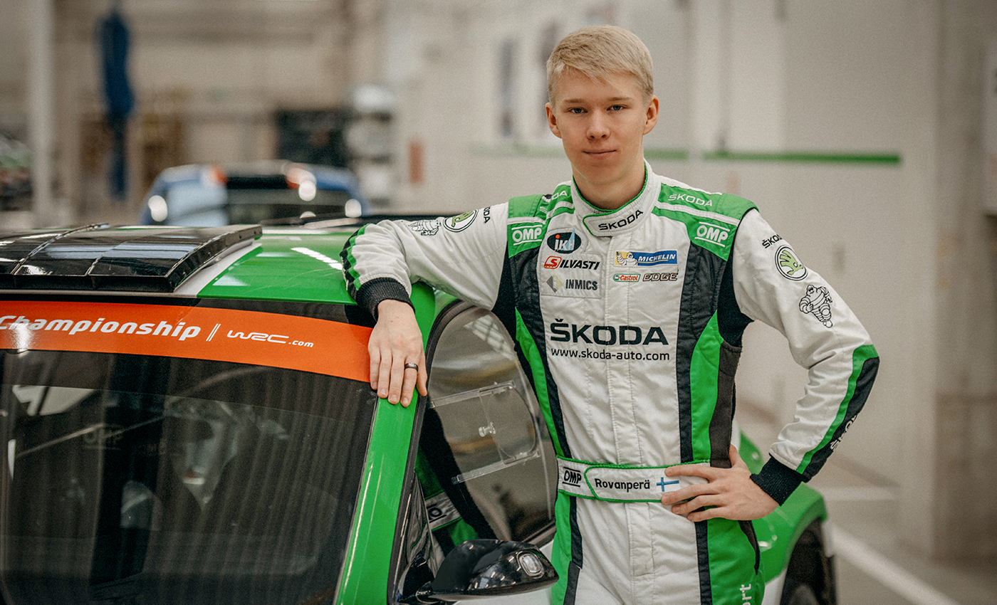 kalle-standing-with-SKODA-FABIA-R5