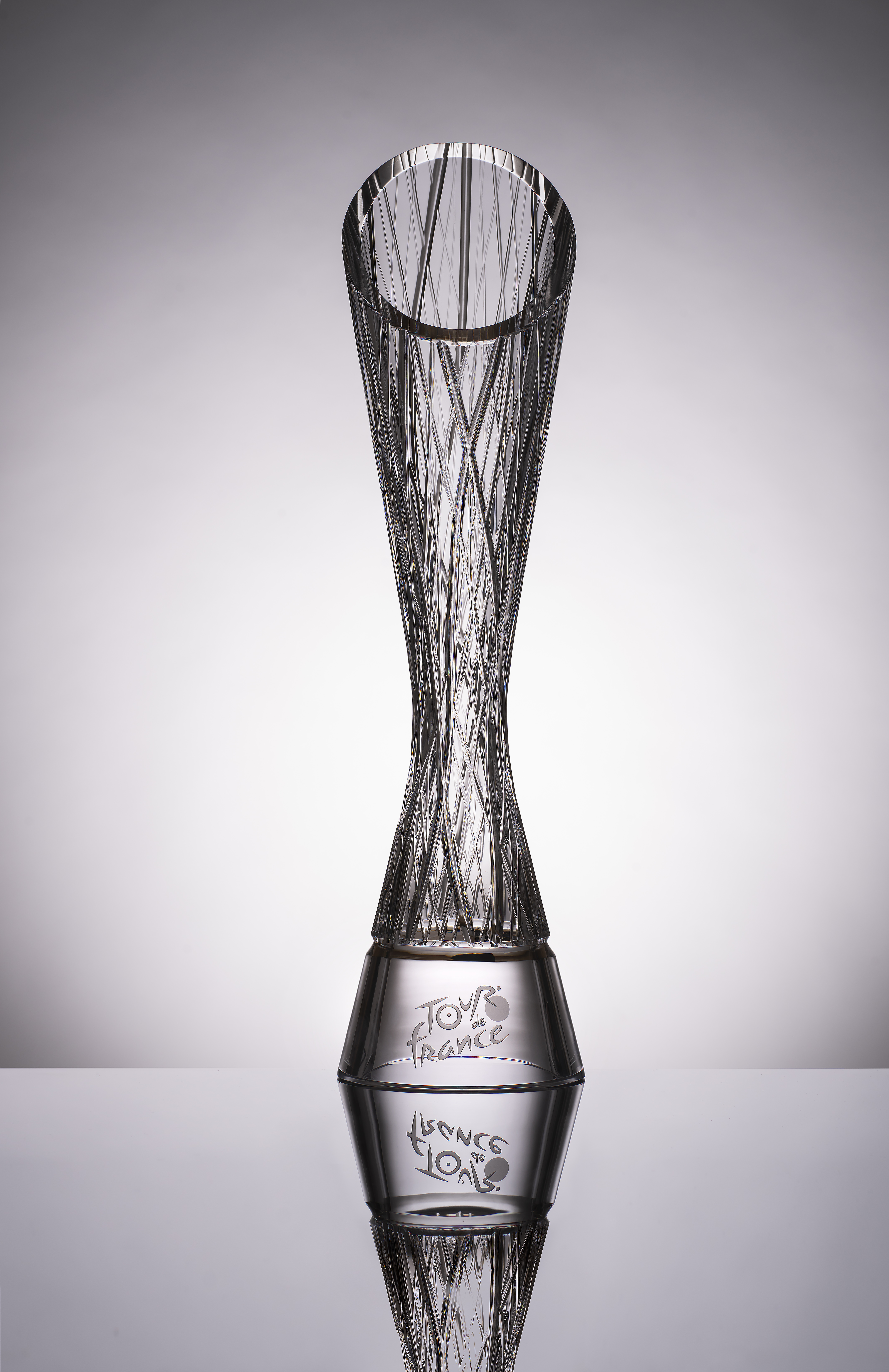 Winner of the 108th Tour de France Tadej Pogačar presented with crystal glass trophy by SKODA AUTO - Image 1